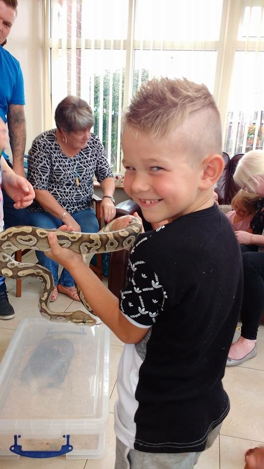 Animal party visit from the ANimal club a boy with python