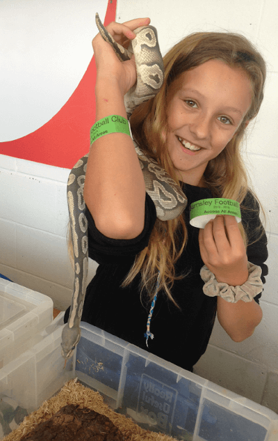 girl with snake at an animal party